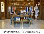 Small photo of SINGAPORE - APR 22, 2018: Interior of Tory Burch Store Front Sign in Marina Bay Sands Mall. Tory Burch is an American fashion label owned, operated and founded by American designer Tory Burch.