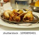 french cuisine  snails in paris ...   Shutterstock . vector #1090890401
