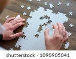 the businessman holds a piece... | Shutterstock . vector #1090905041