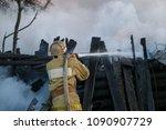 firefighter extinguishes  fire. ... | Shutterstock . vector #1090907729