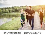group of friends jogging during ... | Shutterstock . vector #1090923149
