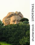 Small photo of Yolodoy Mao looks at you from behind the trees