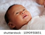 happy baby is lying on the bed | Shutterstock . vector #1090950851