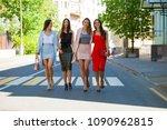 street fashion. four beautiful... | Shutterstock . vector #1090962815