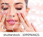 pretty woman massaging her face ... | Shutterstock . vector #1090964621