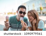 young couple sharing ice cream... | Shutterstock . vector #1090979561