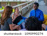 meeting outside the office  on... | Shutterstock . vector #1090990274
