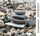 little cairn on a pebble beach | Shutterstock . vector #1091002517