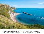 durdle door  dorset in uk ... | Shutterstock . vector #1091007989