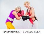 side view of senior sportswomen ... | Shutterstock . vector #1091034164