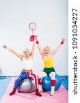 excited senior sportswomen... | Shutterstock . vector #1091034227