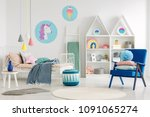 blue armchair and pouf in... | Shutterstock . vector #1091065274