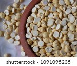 Small photo of Roasted gram in a bowl and pot. Grain and Pulses texture and background. Chana is used for chatni and in a masala items in india