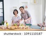 father and daughter cooks in... | Shutterstock . vector #1091110187