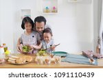father and daughter cooks in... | Shutterstock . vector #1091110439