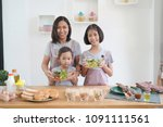 mother and daughter cooking in... | Shutterstock . vector #1091111561