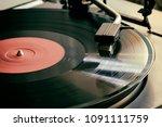 the stylus of the vinyl analog...   Shutterstock . vector #1091111759