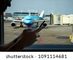 man on the airport using his... | Shutterstock . vector #1091114681