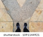 a pair of feet standing at tile ...   Shutterstock . vector #1091144921