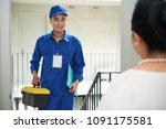 cheerful vietnamese handyman... | Shutterstock . vector #1091175581