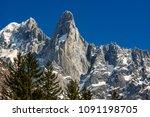 the sheer cliffs of aiguilles... | Shutterstock . vector #1091198705