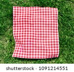 Red Picnic Cloth On Grass Top...