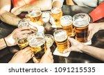 friends hands drinking beer at... | Shutterstock . vector #1091215535