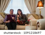 mature couple are relaxing at... | Shutterstock . vector #1091218697