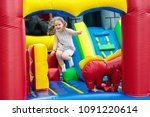 child jumping on colorful... | Shutterstock . vector #1091220614