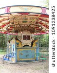Small photo of Liphook, UK - 13 May, 2018: Old steam driven fairground attraction at the Hollycombe Steam Fair. One of several restored rides which were commonplace in the early 20th century.