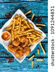 Small photo of Shrimps in batter and fries