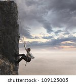 Businessman Climbs The Mountai...