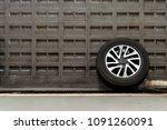 alloy wheels on brick wall at... | Shutterstock . vector #1091260091