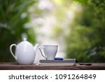 white kettle and cup with... | Shutterstock . vector #1091264849