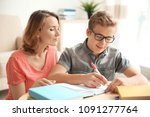 teenager with mother doing... | Shutterstock . vector #1091277764