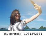 portrait of a cute asian...   Shutterstock . vector #1091342981
