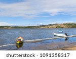 lake with fishermans boat near... | Shutterstock . vector #1091358317