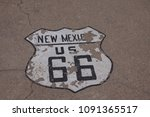 Small photo of Warn off street mark route 66 sixty six in New Mexico