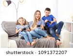 young woman playing video games ... | Shutterstock . vector #1091372207