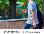 a guy with a smartphone is... | Shutterstock . vector #1091376629