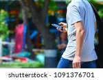 a guy with a smartphone is... | Shutterstock . vector #1091376701