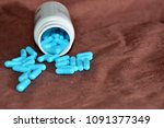blue medications are scattered... | Shutterstock . vector #1091377349