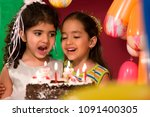 two girls with a birthday cake | Shutterstock . vector #1091400305