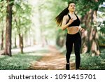 fit young woman running in city ... | Shutterstock . vector #1091415701