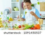 young guy in the kitchen  | Shutterstock . vector #1091450537