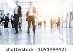 blurred people at a trade fair... | Shutterstock . vector #1091494421