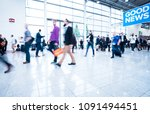 blurred people at a trade fair... | Shutterstock . vector #1091494451
