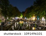 Bikes In The Night Of Amsterdam