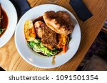 vegetarian dinner with nut... | Shutterstock . vector #1091501354