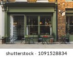 Stock photo empty coffee terrace with tables and chairs in marylebone london 1091528834